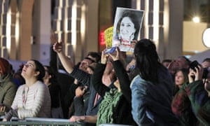 Demonstrators hold up an image of Daphne Caruana Galizia protest outside Malta's parliament, in Valletta, on 26 November.