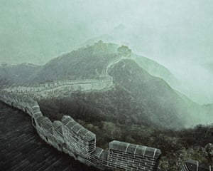The Great Wall of China. The majority of the early walls were built at the start of the seventh century. Today, what is left was built during the Mong Dynasty. Here, a small section peers up through the early morning mist creating a traditional painterly effect on the outskirts of Hohhot, Inner Mongolia.