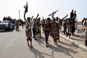 Soldiers wave guns in the air in Yemen