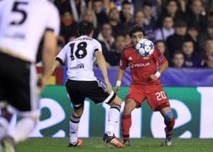 Valencia's Javi Fuego attempts to thwart Lyon's Rafael