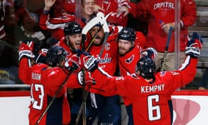 Alex Ovechkin celebrates with team-mates after scoring a second-period goal