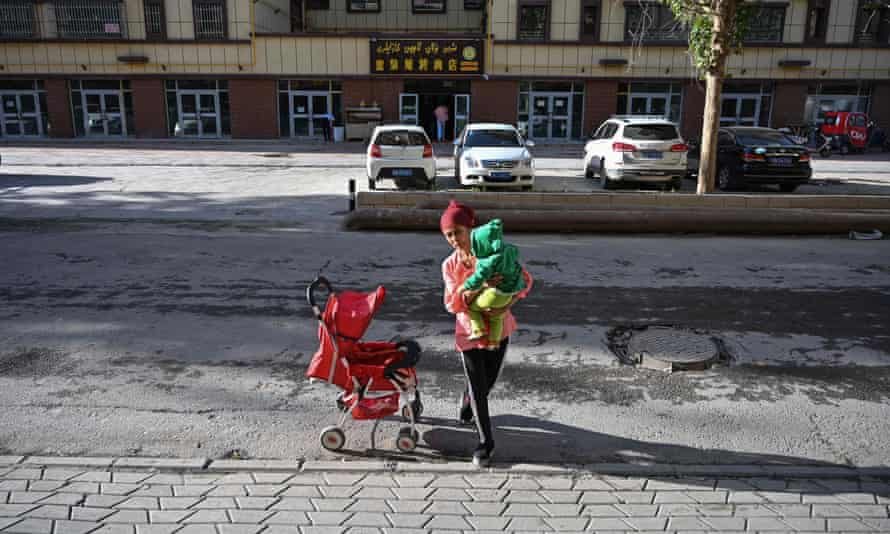A mother in Aksu in China's Xinjiang region, where women are being threatened with internment for refusing to abort pregnancies that exceed birth quotas.