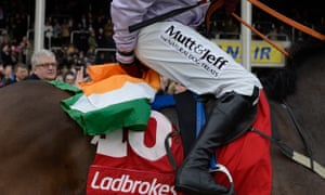 After victory in the World Hurdle in 2013, Paul Carberry on Solwhit tucks an Irish flag under his bottom that was thrown from the crowd.