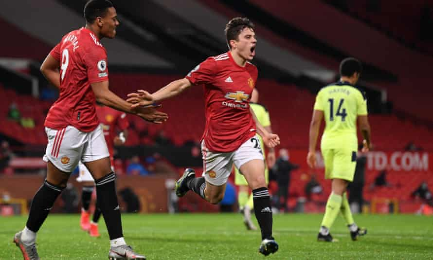 Daniel James of Manchester United (centre) celebrates scoring against Newcastle with Anthony Martial (left).