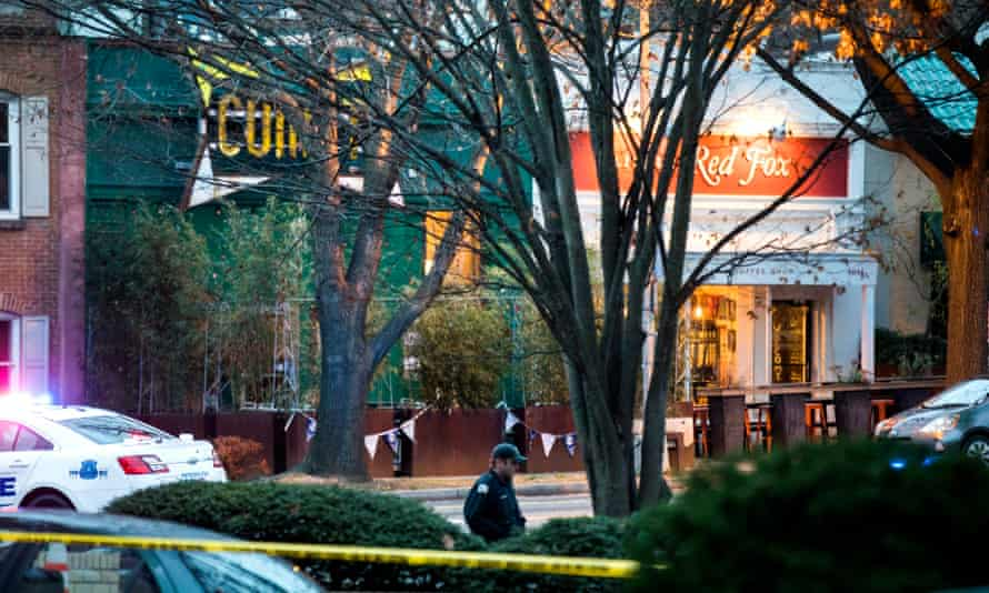Police at the restaurant at the centre of 'Pizzagate'