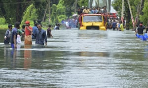 Kerala floods: many thousands await rescue as downpour