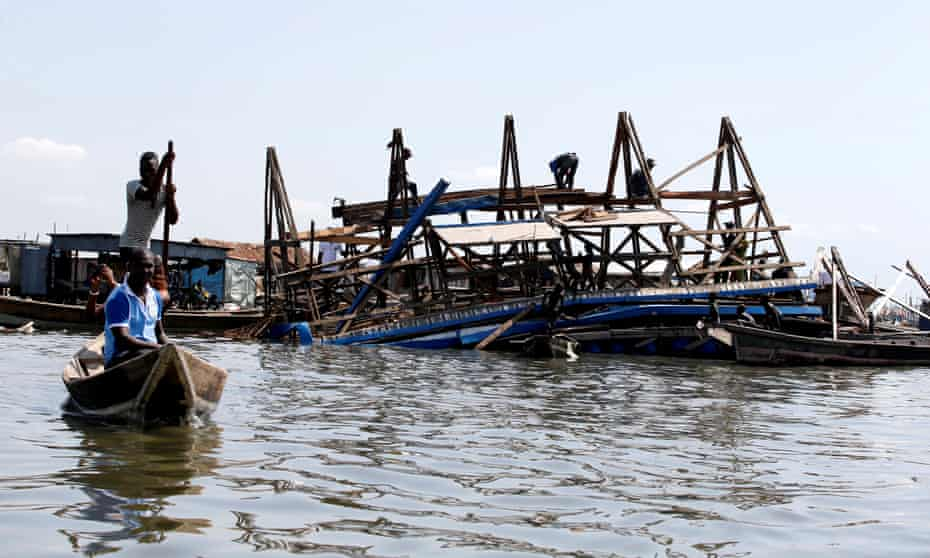 Residents work to dismantle the Makoko floating school after it collapsed.