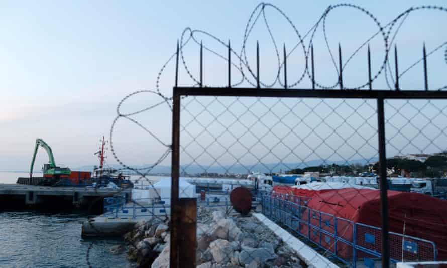 Tents and barbed wire at Dikili Harbour in Izmir, Turkey