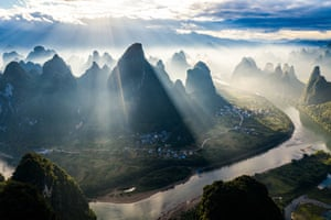 Guilin, China: Dawn breaks over the Li River and Xianggong mountain
