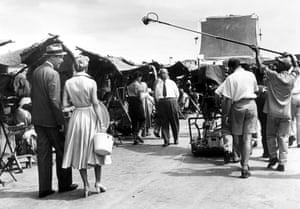 Alfred Hitchcock directs Doris Day and James Stewart on set of the 1956 thriller The Man Who Knew Too Much