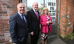Sinn Fein candidates for Foyle Raymond McCartney, Martin McGuinness and Maeve McLaughlin arrive at a polling station at Model Primary School in Londonderry.