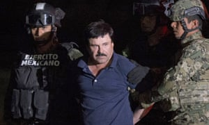 Joaquin 'El Chapo' Guzmán is escorted by army soldiers to a waiting helicopter in January.