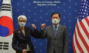 US deputy secretary of state, Wendy Sherman, and South Korea's foreign minister, Chung Eui-yong, bump elbows at the foreign ministry in Seoul today.