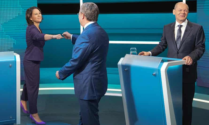 The TV debate between the Green party's Annalena Baerbock, left, the CDU's Armin Laschet, centre, and the SPD's Olaf Scholz started off on a more cordial note.