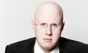 Matt Lucas, bald head, glasses, serious expression looking straight at the camera