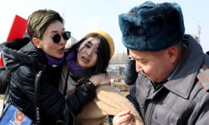 A FEMEN activist is detained by Kyrgyz police on Victory Square during the celebration of International Women's Day in Bishkek, Kyrgyzstan, 08 March 2020.