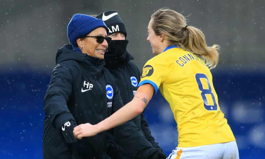 Brighton and Hove Albion head coach Hope Powell celebrates with Megan Connolly after the match.
