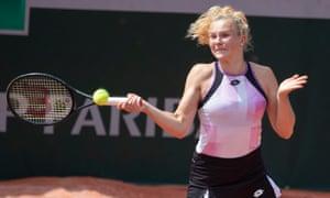 Katerina Siniakova flings a forehand to Veronika Kudermetova.