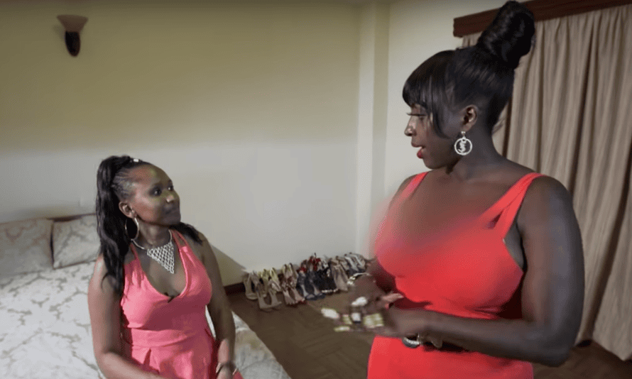 A still from the BBC Africa documentary Fake Me: Living For Likes featuring the Kenyan social media star Glamour Pam (right) with blurred cleavage.