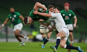 Iain Henderson of Ireland is tackled by Ben Youngs of England.