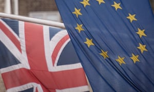 A British and EU flag.
