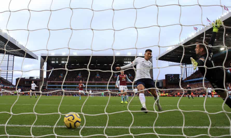 Liverpool's Roberto Firmino scores a goal against Aston Villa at Villa Park on 2 November, before it is disallowed by VAR.