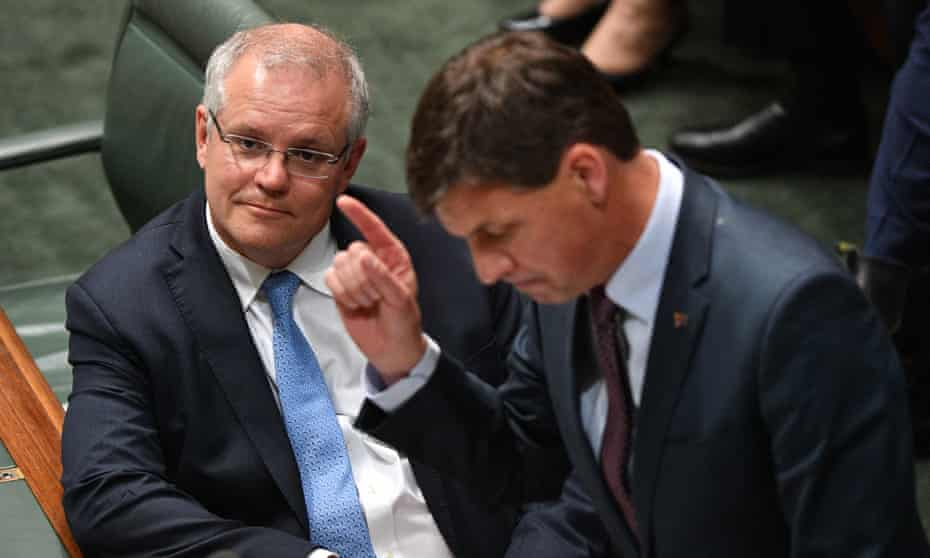 Scott Morrison (left) energy minister Angus Taylor during question time. The prime minister said Australia would meet its Paris targets largely based on investment in renewable energy technologies.