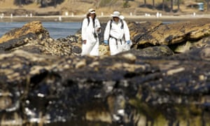California oCrew members inspect the oil spill damage at Refugio State Beach in Goleta, California May 22, 2015. As much as 2,500 barrels (105,000 gallons) of crude oil, according to latest estimates, gushed onto San Refugio State Beach and into the Pacific west of Santa Barbara when an underground pipeline running parallel to a coastal highway there inexplicably burst on Tuesday morning. REUTERS/Jonathan Alcorn