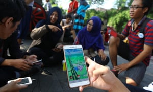 People gather to play the Pokemon Go game on their cellphones in Surakarta, Indonesia.