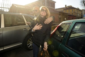 """January 2011: Nadia Macri is escorted as she arrives at the offices of the judicial police for a hearing in the """"Rubygate"""" scandal. Macri claimed she had had sex with, and received money from, Berlusconi"""