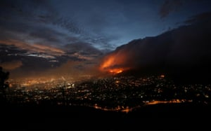 Cape Town, South Africa. Flames are seen close to the city, fanned by strong winds after a bushfire broke out on the slopes of Table Mountain