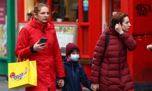 A child wearing a mask in Chinatown, London