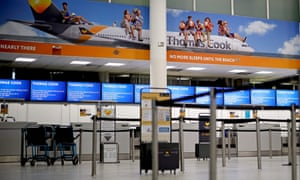 The closed deserted Thomas Cook check-in desks at Gatwick.