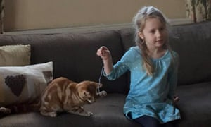 Eliza Adamson-Hopper playing with her cat Mittens