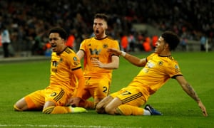 Wolverhampton Wanderers' Helder Costa celebrates with Matt Doherty and Morgan Gibbs-White after scoring their third goal.