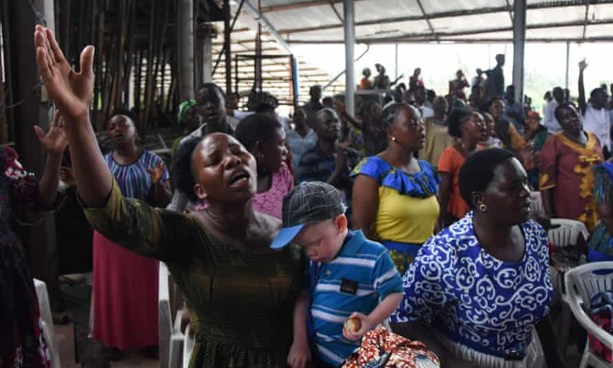 Worshippers attend mass at a church in Dar es Salaam this month without wearing masks or practising social distancing.
