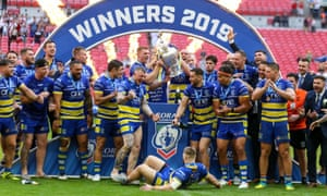 Warrington Wolves players celebrate winning the Challenge Cup Final