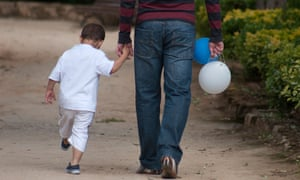 A father with his son. Just one in 100 men requested parental leave in the year after the policy debuted.