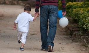 little boy holding hand of man
