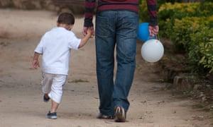 little boy holding fathers hand. Image shot 2011. Exact date unknown.<br>CEFT22 little boy holding fathers hand. Image shot 2011. Exact date unknown. Shesaid