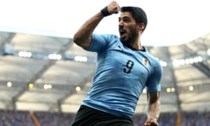 Luis Suarez celebrates after opening the scoring for Uruguay