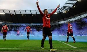 Robin van Persie celebrates his 90th-minute winner against Manchester City on 9 December 2012