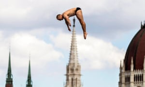Russia's Igor Semashko competes in the semi-final of the men's 27m high diving competition in Budapest