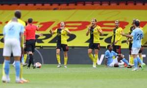 Watford players react as referee Micheal Oliver awards the penalty.