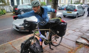 Writer Liz Dodd with her bicycle on a pavement in London.