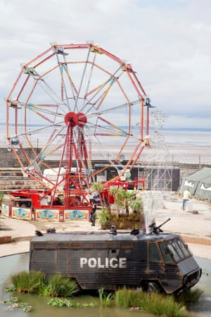 Banksy's police van fountain with the ferris wheel behind