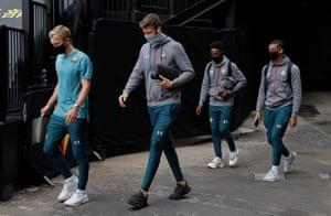 Southampton players enter Vicarage Road wearing masks.