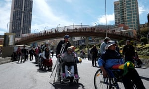 Demonstrators with physical disabilities in La Paz, Bolivia attend a protest calling on the government to provide a monthly subsidy for disabled people rather than an annual one.