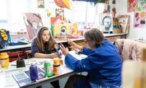 Helena Kitchingman, a pupil at the Grove Academy, Harrogate, in an art class with teacher Kate Kersey.