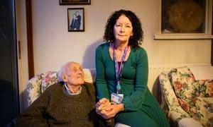 Community nurse Veronica Peters visits 103-year-old Alfred Mann in Croydon.